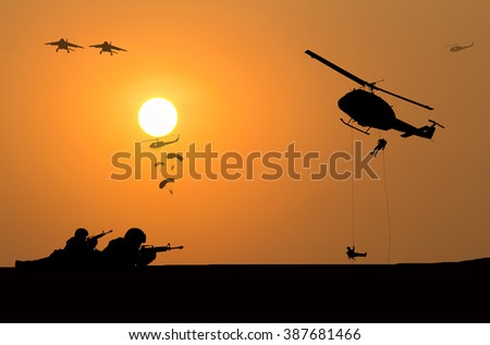 helicopter and soldier silhouette  - stock photo