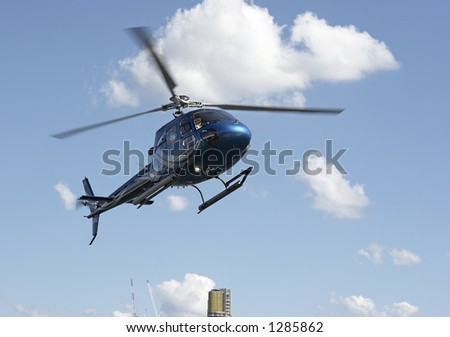 Helicopter coming in for a landing - stock photo