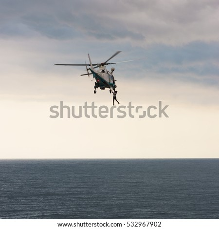 Helicopter evacuates pilot from cargo ship