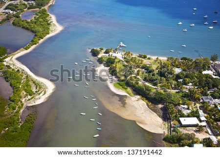 Helicopter flight above the island of Mauritius. Photo shows the south coast. - stock photo
