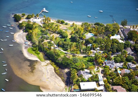 Helicopter flight over the island at Mauritius. - stock photo