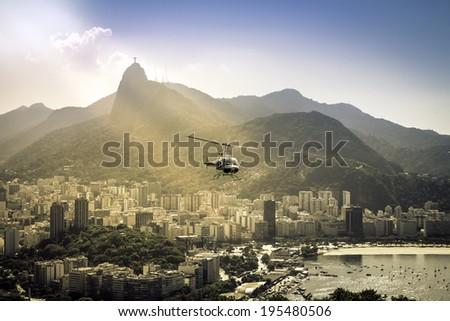 Helicopter flying above Rio de Janeiro Brazil. Sunshine leaks. - stock photo