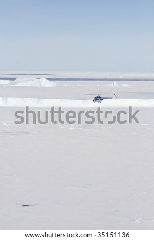 Helicopter flying above the sea ice in the Weddell Sea, Antarctica