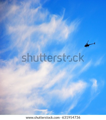 Helicopter goes to the clouds