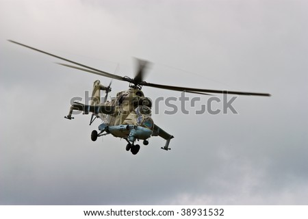 Helicopter gunship conducting high altitude training operations