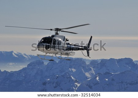 Helicopter in the Alps - stock photo