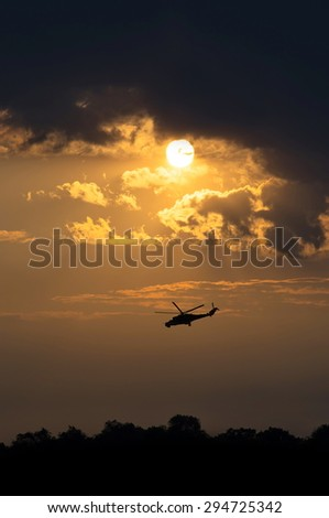 helicopter in the night sky - stock photo