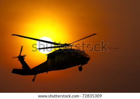Helicopter landing at sunset