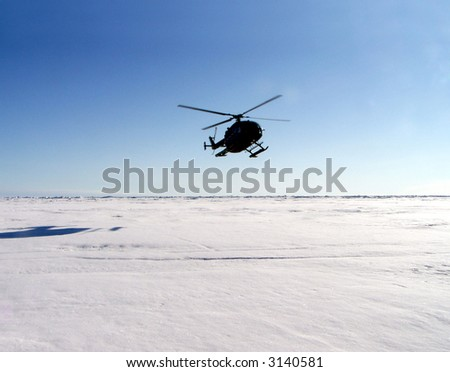 Helicopter landing in Antarctica - stock photo