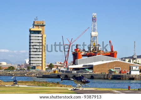 helicopter lands near oil rig in the bay of cape town, south africa - stock photo