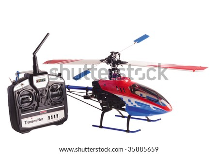 Helicopter model and radio remote control set isolated on white - stock photo