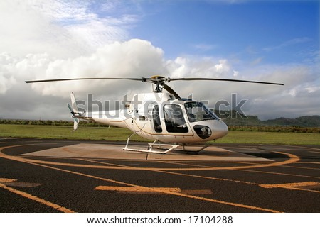 Helicopter on landing pad - stock photo