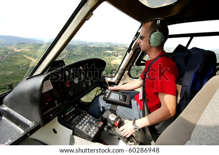 Helicopter pilot in flight - stock photo
