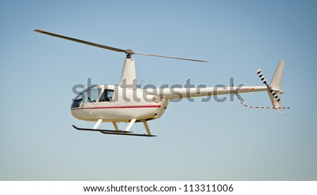 Helicopter Robinson at the sky - stock photo