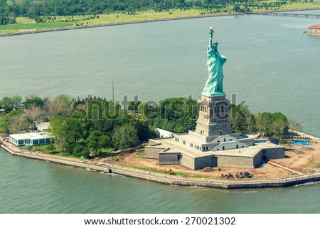 Helicopter view of Statue of Liberty. - stock photo