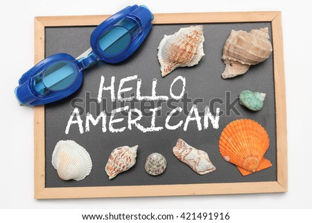 Hello American text on chalk board with swimming goggle and shell - vacation and business concept - stock photo