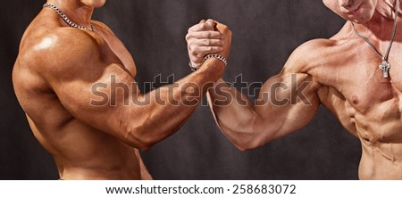 Hello athletes. Two bodybuilder shake hands - stock photo