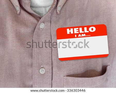 Hello I Am blank name tag worn by person in red button shirt - stock photo