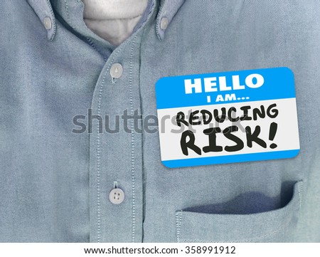 Hello I am Reducing Risk words written on a blue name tag on a worker or consultant in a shirt who is decreasing danger or liability to increase safety and security