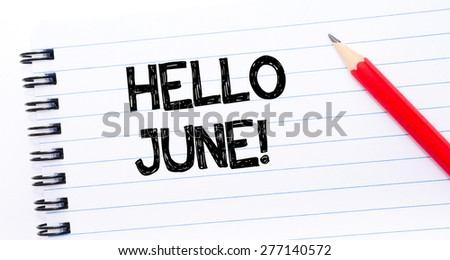 Hello June Text written on notebook page, red pencil on the right. Concept image