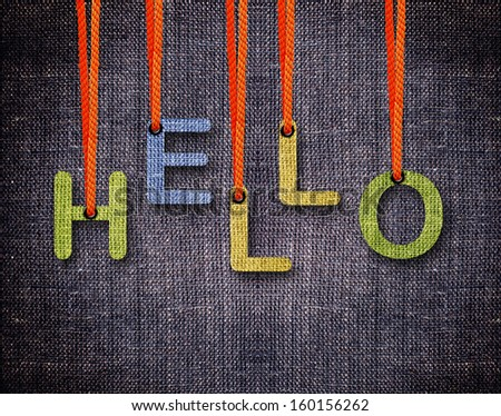 Hello Letters hanging strings with blue sackcloth background. - stock photo
