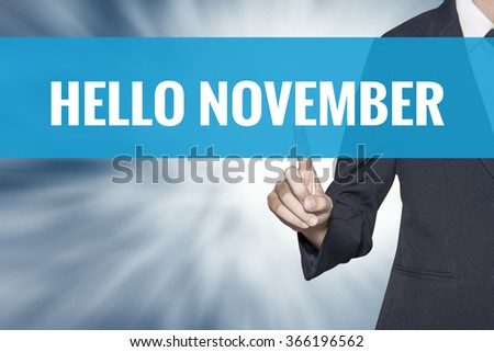Hello November word on virtual screen touch by business woman cyan sky tab - stock photo