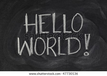 Hello, World! message from a first computer program used in many introductory tutorials for teaching programming language, white chalk handwriting on blackboard - stock photo