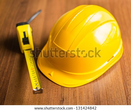 Helmet and measuring ruler on the table
