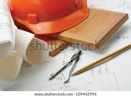Helmet draft, compass, plan - stock photo