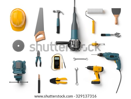 helmet, drill, angle grinder and other construction tools on a white background isolated - stock photo