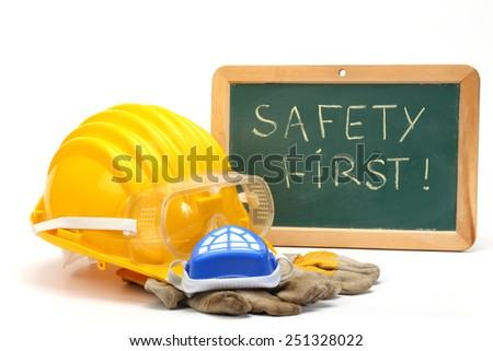 helmet, goggles, gloves and greenboard. safety first concept - stock photo