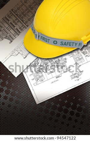 Helmet of constructor with blueprints building construction - stock photo