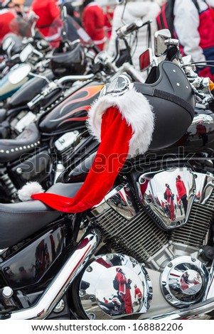 Helmet on a motorcycle of Santa Claus. - stock photo