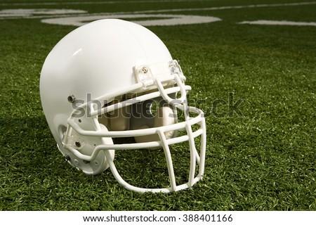 Helmet on American football field - stock photo