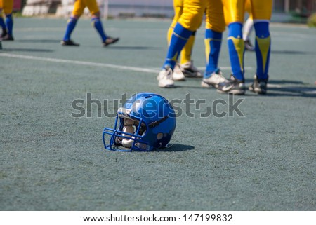 helmet player in college football, head protection - stock photo