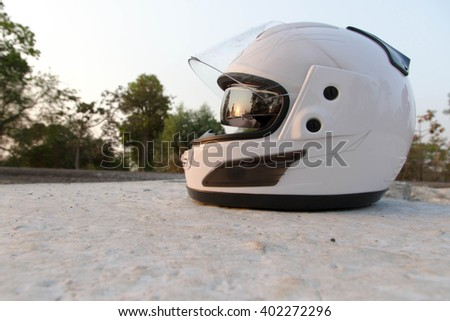Helmet Safety bright white on the concrete floor.