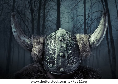 Helmet, Viking warrior, male dressed in Barbarian style with sword, bearded - stock photo