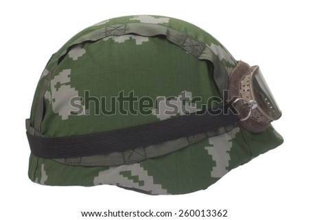 helmet with camouflage cover and protective goggles - stock photo