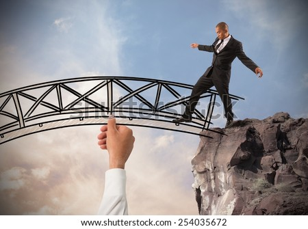 Help a businessman to overcome an obstacle - stock photo