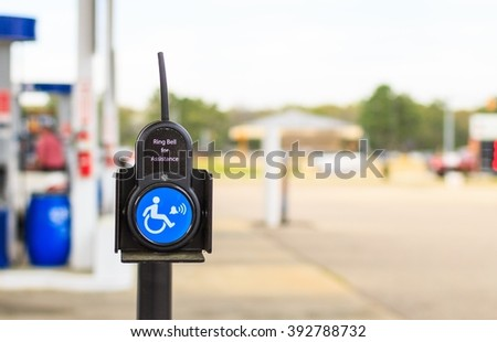 Help At The Pump Handicap Assistance: A mobile two way radio or ringing  apparatus at a gas station on a military base used to request assistance from the store tenant if needed. - stock photo