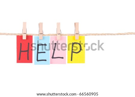 Help, Colorful words hang on rope by wooden peg