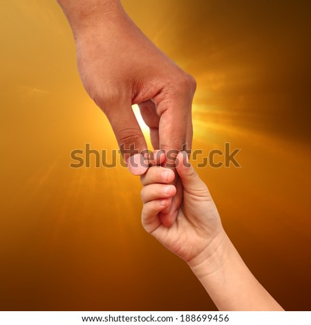 help concept, Helping hand on sunshie background - stock photo