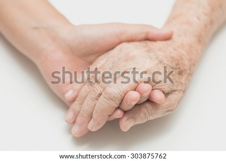 Help concept,The helping hands for elderly home care, Holding hand, noise and film grain style. - stock photo