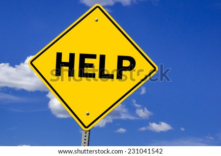 Help Conceptual Sign Against blue Sky - stock photo