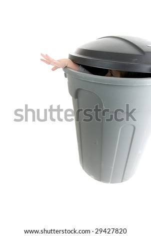 Help - hand reaches out from garbage can - stock photo