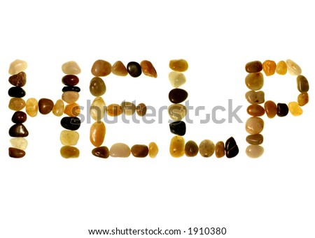HELP in colored stones on an isolated white background