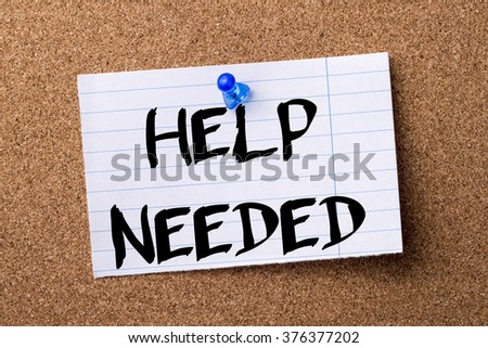 HELP NEEDED - teared note paper  pinned on bulletin board - horizontal image - stock photo