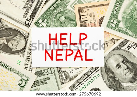 Help Nepal written on white card with US dollar bills as a background. - stock photo