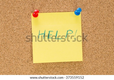 Help note pinned to corkboard background - stock photo