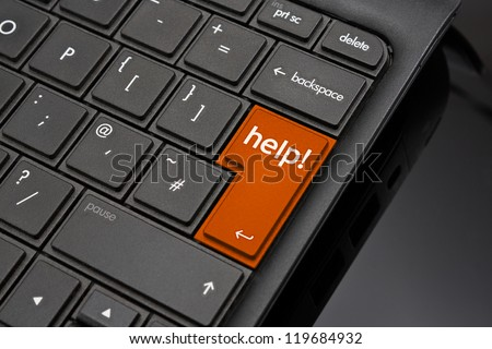 Help Return Key symbolizing a user requesting support to help repair a crashed or damaged computer - stock photo